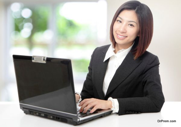 Business woman using computer at office