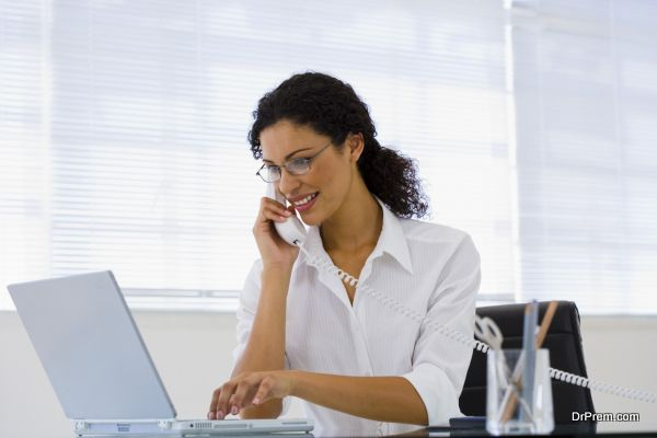 Woman with a telephone and laptop computer