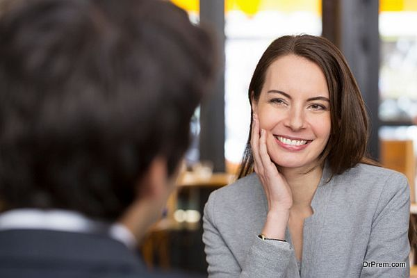 Portrait of beautiful woman during lunch with man in restauraurant