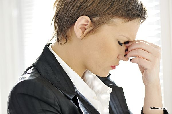 Young depresses stressed business woman at office