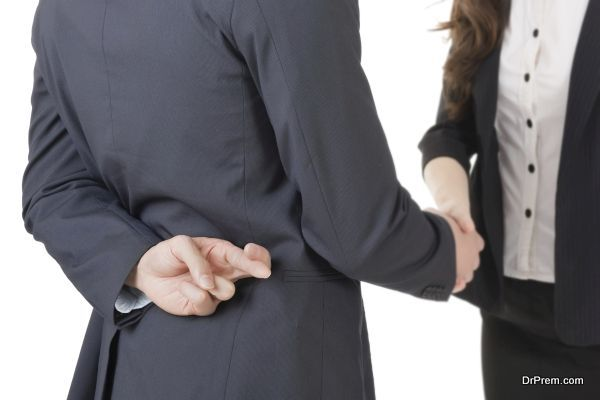 Business woman and man shake hands and put finger cross on back, closeup portrait isolated on white background.