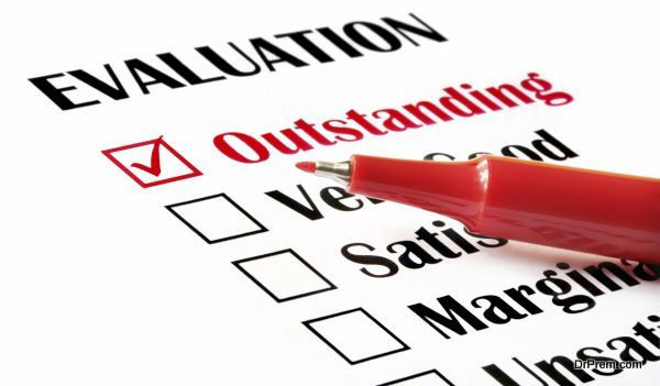 """""""Outstanding"""" checked on evaluation form, with red pen."""