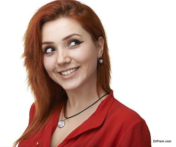 Pretty red-haired girl having fun plotting