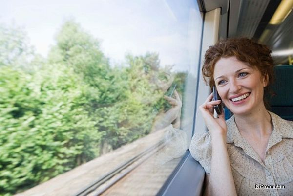 Woman on cell phone in train