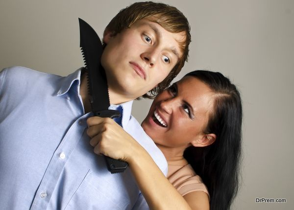 Woman is trying to kill man by knife.