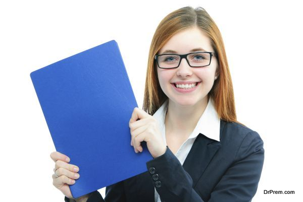 Happy young candidate holding files for a job interview