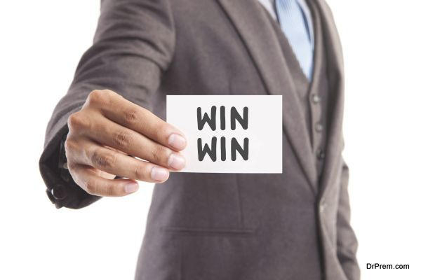 "Businessman hand showing someone his business card with""WIN WIN"" message"