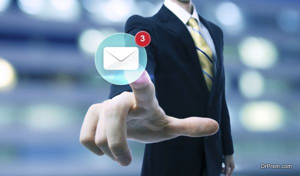 Businessman pointing at an email icon