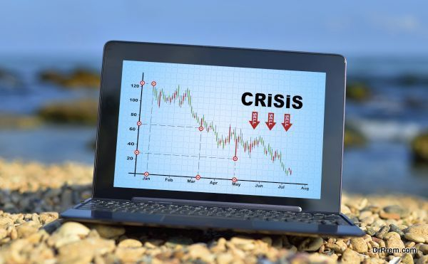 laptop with crisis chart
