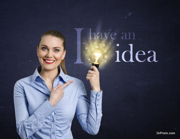 Woman holding bright bulb, concept - I have an idea