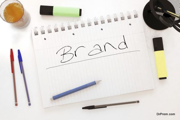Brand - handwritten text in a notebook on a desk - 3d render illustration.