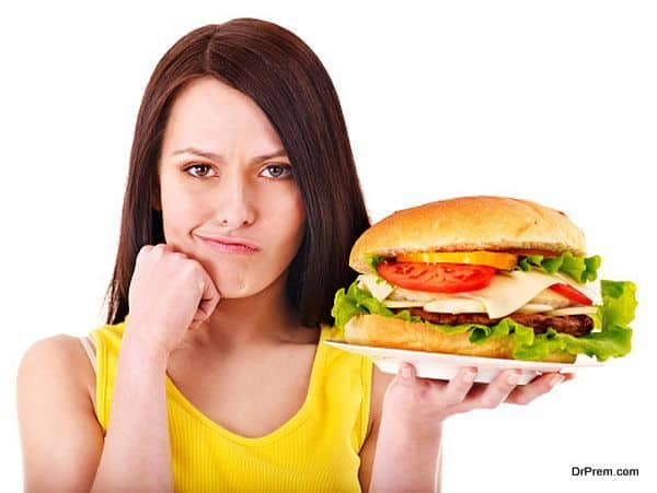 Photo of Chomping on junk food can help you lose weight