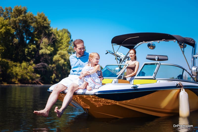 Pleasant young family relaxing on a motorboat