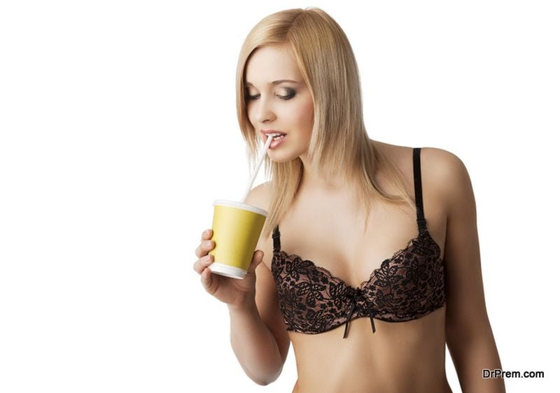 woman-using-plastic-straw-to-drink