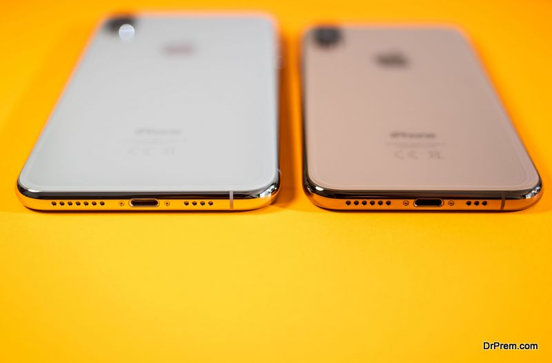rear view of Apple iPhone Xs Max orange background