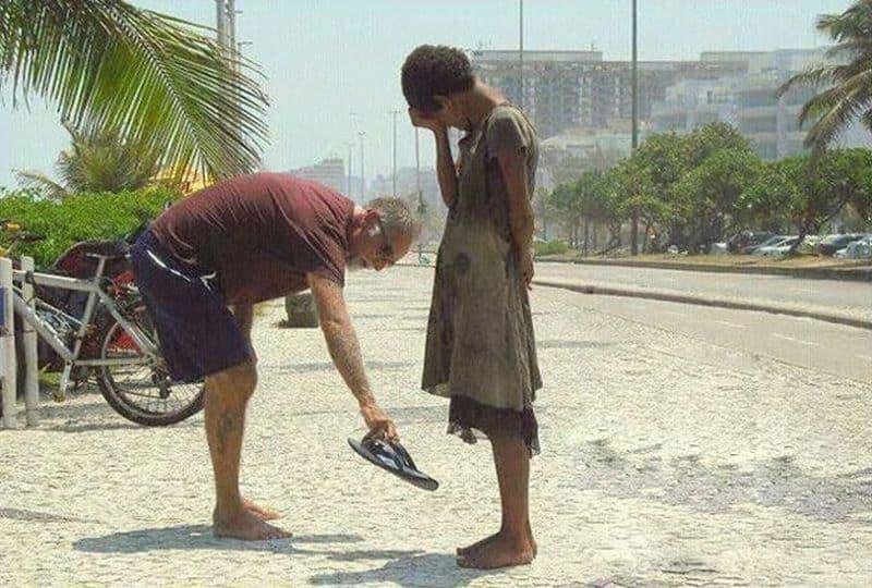 A man donates his shoes to a homeless Rio de Janeiro girl