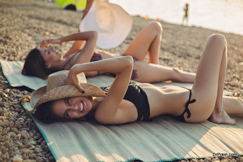 women relaxing on beach