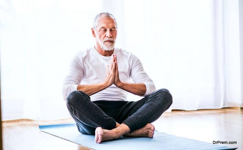 senior male doing yoga