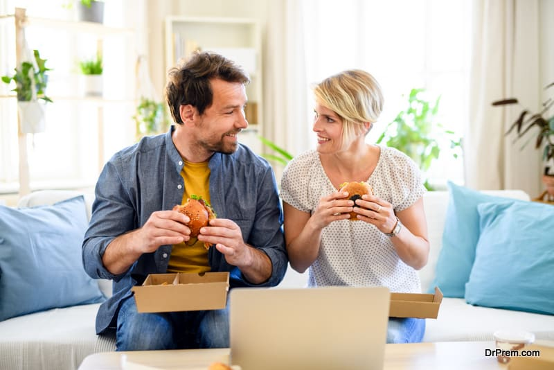 couple consuming junk