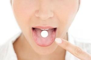 Woman-taking-medication-1858419