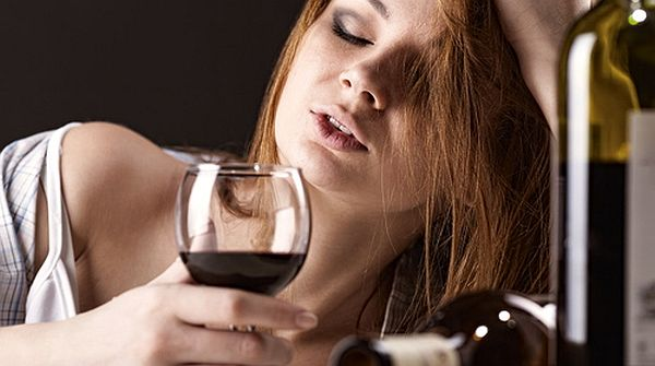 Young-beautiful-woman-in-depression-drinking-alcohol-Shutterstock