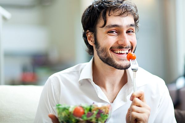 bigstock-Young-man-eating-a-healthy-sal-43484335