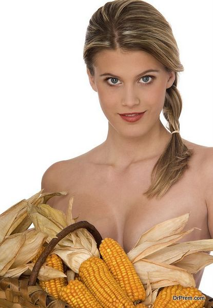 Healthy looking girl holding a basket full of corn