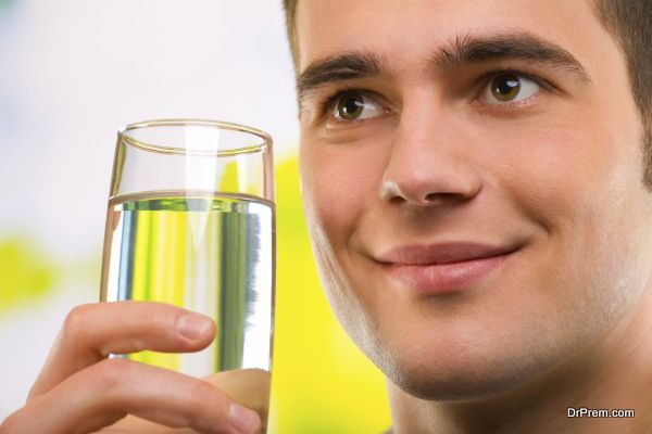 Portrait of young man with glass of water