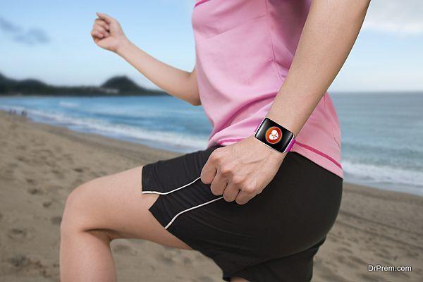 sport female wearing bright pink watchband bent touchscreen smartwatch