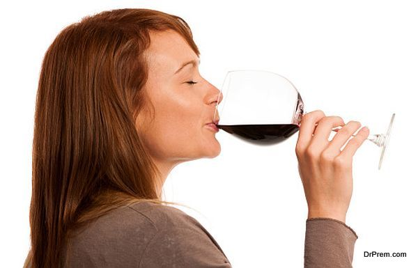 Attractive brunette with a glass of wine isolated