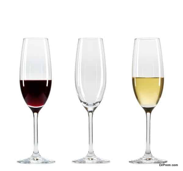 Set of three wine glasses with different types of wine