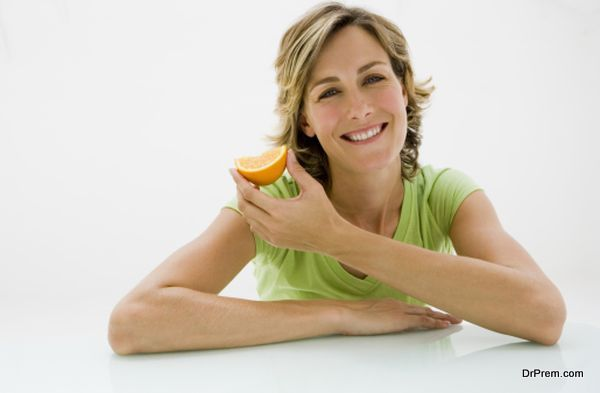 Woman with orange slice
