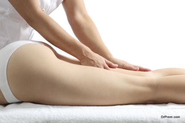 Side view of a woman legs receiving massage therapy