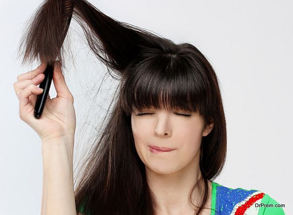 Woman trying to get a brush out of her hair