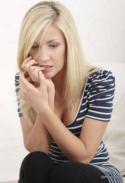 Woman eating her nails becouse of stress
