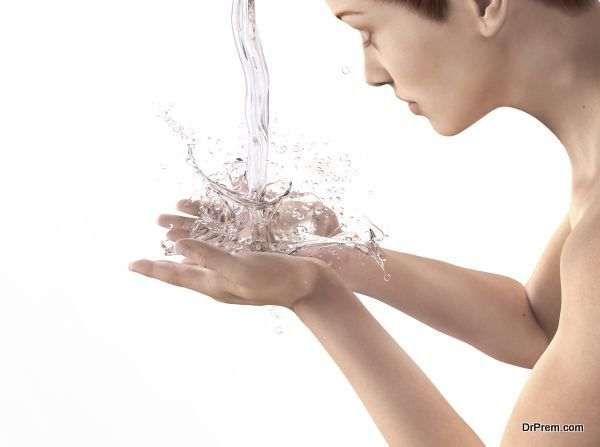 Beautiful woman washing her face isolated