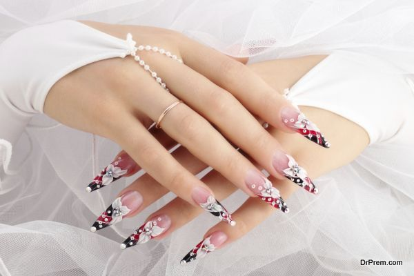 Hands of the bride with beautiful nails.