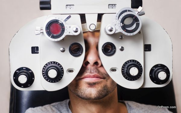 Man in optometrist phoropter redy for eye exam calibration