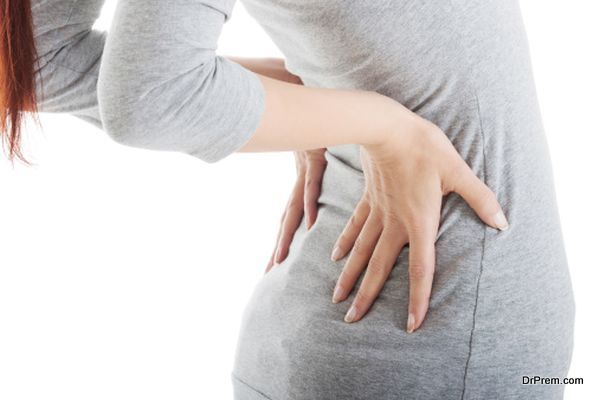 Young woman is having back pain.