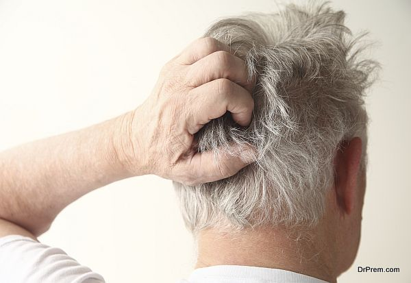 senior man scratching head