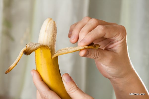 hands peeling a banana