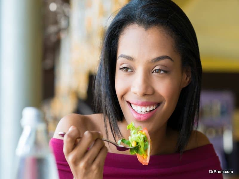 Girl eating fresh salad
