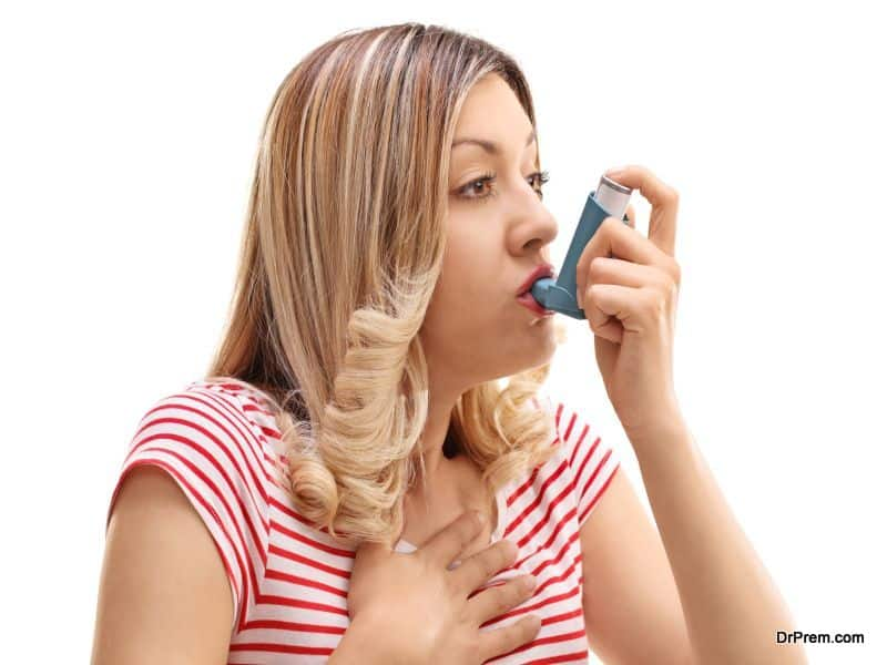 Woman inhaling her asthma medication