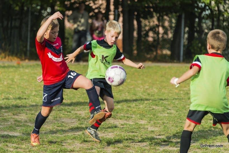 Boys play football