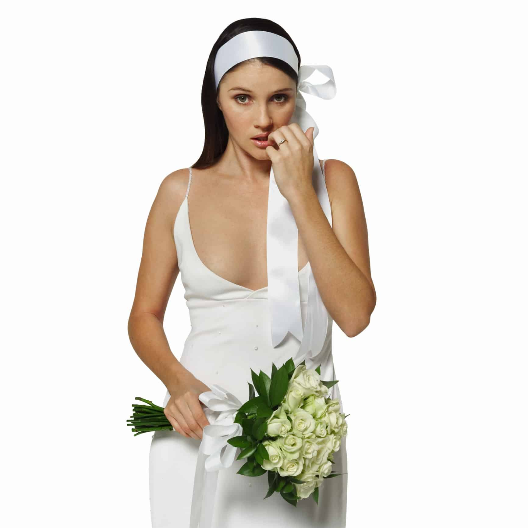 front view portrait of a worried bride holding a bouquet
