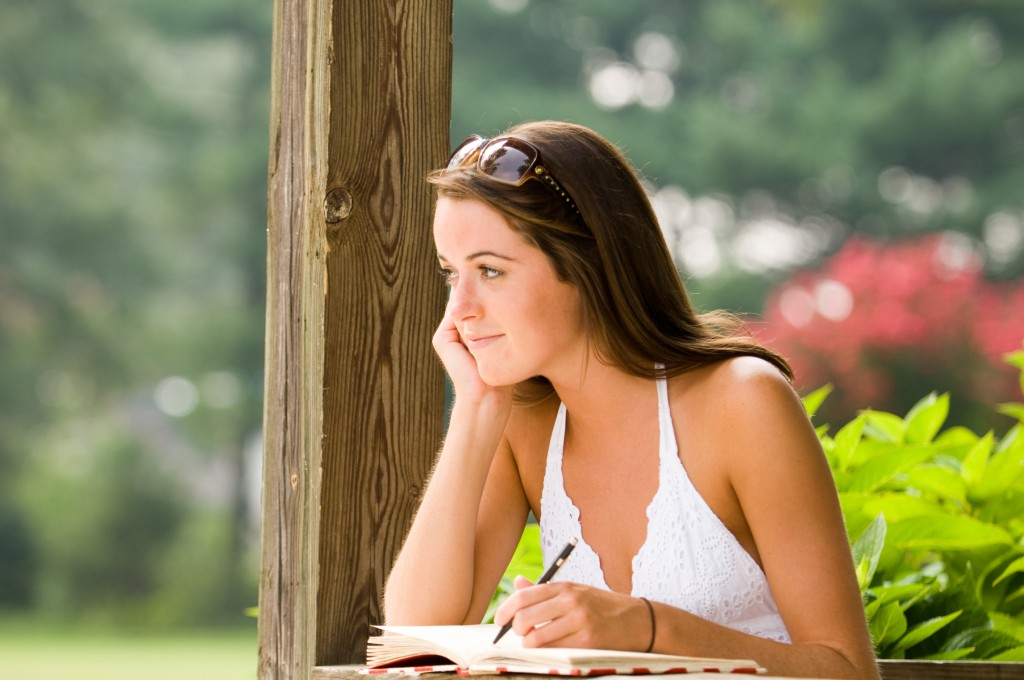 Girl Laughing and Writing