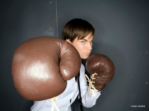 Employee in boxing gloves