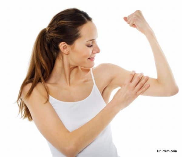 woman showing muscle bicep