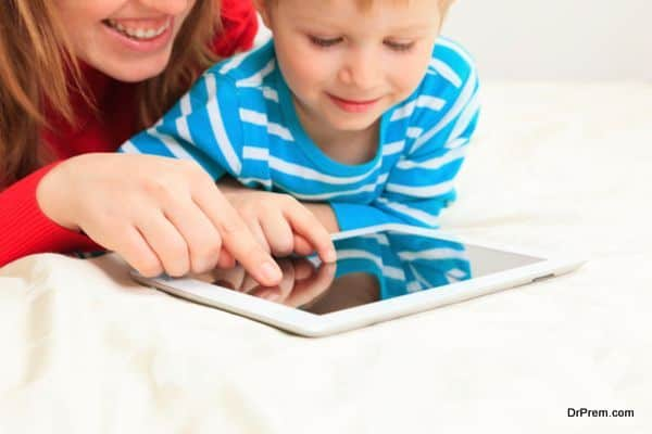 Family with touch pad at home