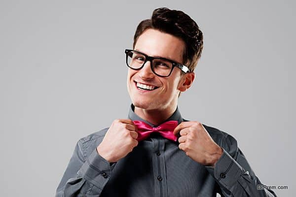 Smiling man with pink bow tie